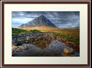 Moody River - A moody landscape scene showing River Coupall riverbed with the mountain Buachaille Etive Mòr in the Highlands of Scotland